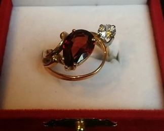 14Kt Gold set with a Garnet and White Sapphire