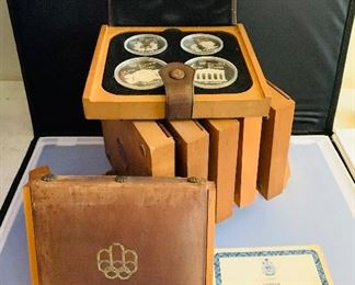 1976 Canadian Olympic Silver Coin Set with certificates of Authenticity, 7- 4 piece sets, 5 and 10 dollar coins