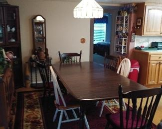 Dining Room Table with 4 matching chairs.  Has leaf to expand even larger