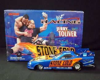 Two Action 1:24 Scale Diecast Funny Cars, Jerry Toliver WWF/Stone Cold 2000 Camaro And WWF/ XXL 2001 Firebird