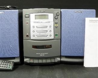 Sony Personal Component System Model PMC-107 Plays Radio, CD And Cassette With Alarm, Speakers And Manual, Powers On