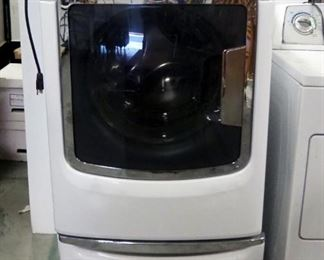 Maytag Maxima Front Load HE Electric Washer, Model MHW6000XW2, With Lower Storage Compartment, Some Dents On Sides, Powers On