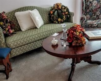 sofa, needlepoint bench, wingback, library table converted to coffee table