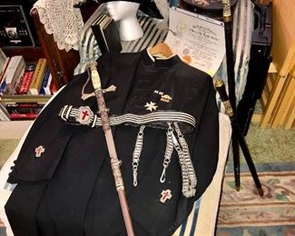 Masonic regalia...Frock coat, sword and belt, plumed hat, and books.