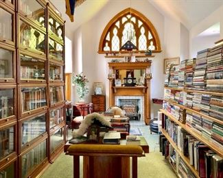 Beautiful library filled with books, 4 tall barrister book cases, an amazing library/writing desk, quilts, antiques, and so much more!