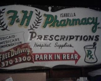 Huge metal sign from Fred Isablella's Pharmacy on Union Street.