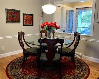 Glass Top and Granite Dining Room Table and Chairs,  Large round area rug, 8 foot diameter.