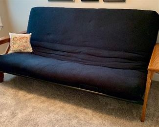 Black cushioned futon