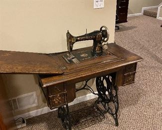 MINNESOTA A ANTIQUE SEWING MACHINE WITH CABINET