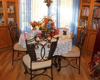 Glass Kitchen Table w/4  Chairs -This house is packed with treasures so we have this item is available for presale. Call 530-693-038