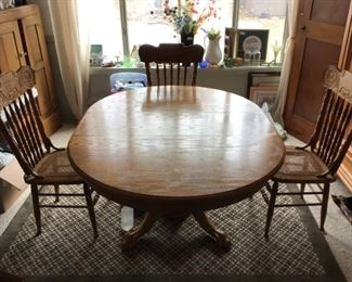 Claw Foot Oak Dining Table with Pressed Back Caned Chairs