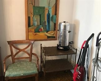 More wonderful wall art next to a folding metal serving cart. You can entertain a lot of guests with a coffee pot like this one! Also a large selection of vacuum cleaners! The armchair of which there is 2 belong to the dining room table set also by Drexel!