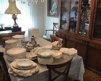 Lovely china sets to pictured after set-up by Lenox and others. The large china cabinet and table set and server are by Drexel. The cabinet holds serving pieces and leaded crystal!