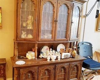This china cabinet has a unique vintage look with plenty of storage