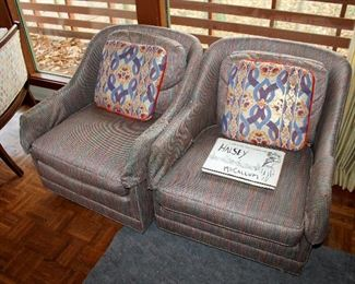 Upholstered rolling armchairs
