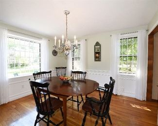 Hitchcock dining table with six chairs. Country Curtain sheer white curtains.