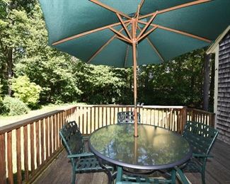 Glass patio table. Six chairs available. Umbrella with base.