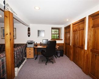 Computer desk with chair, file cabinet, laser printer, monitor.