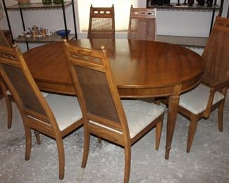 """Side view:  Vintage Dining Table ( 65"""" x 44"""" w/3 12"""" Table leaves) and 2 cane high back Arm Chairs and 4 side chairs"""
