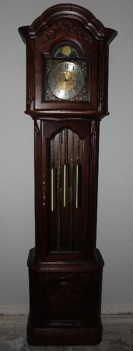 """Howard Miller triple chime: Westminster, St. Michael's and Whittington, Traditional Grandfather Clock with Moon Dial.  (79""""H x 12""""D x 19""""W)"""