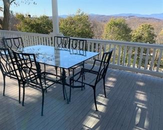 Antique glass top patio table with nice iron chairs