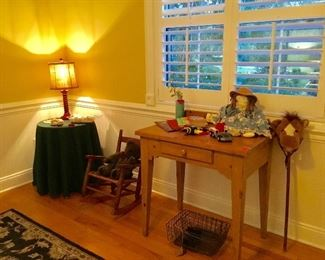 Nice pine table, nesting wire baskets, child's rocker, toys, doll, baby clothes