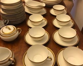 Bone China gold rimmed place settings. Complete with cups and saucers