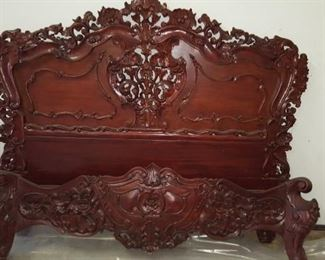 Very ornate hand carved mahogany queen bed.