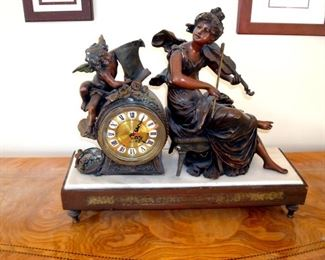 Bronze figural shelf clock with marble & wood base.