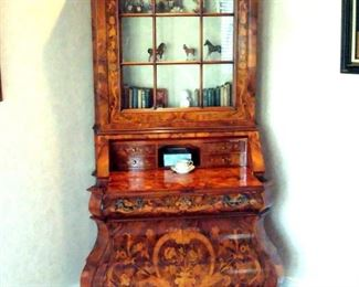 Hand made and intricately inlaid Italian secretary with drop front desk, paw feet, and bonnet top.
