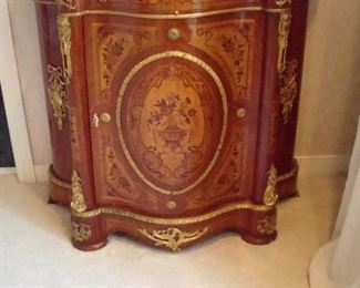 Vintage intricately inlaid Italian bombe commode with gilt bronze decoration and grey marble serpentine top.