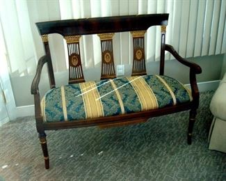 Federal style settee with gilt accents.