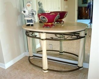 White marble top center  table with posts and bronze supports.