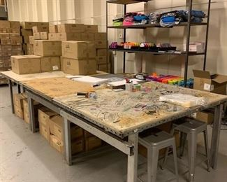 work tables and stools and steel shelving unit