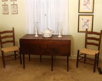 Southern walnut dropleaf swing leg table and pair of antique chairs with Hunter family seats.