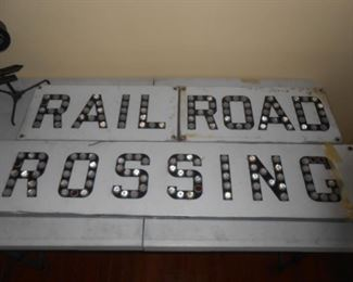 """This RR sign is made of metal - smaller sections are approx 2' W x 15"""" H - Large piece approx 5.5' W x 15"""" H"""