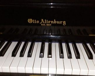 More Recent Otto Altenburg, Est. 1847, modern black gloss spinet piano.