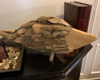 Wooden fish sculpture.