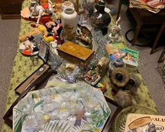 Fostoria stemware, alaskan dolls, serving trays, music boxes, asian vases, toys, Italian music box, Hummel. antique dolls, and more...so much more.
