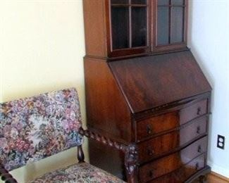 Vintage secretary, one of several antique carved chairs