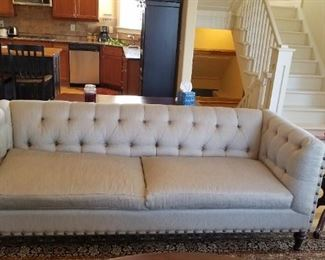 Beautiful button back nail trimmed sofa. Like new.