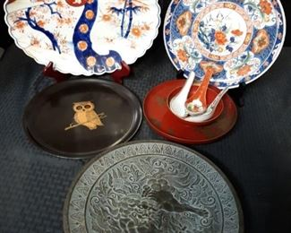 Ornate asianinspired plates and serving dishes
