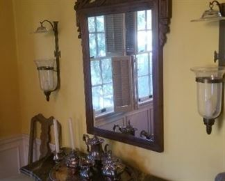 Large antique half moon iron console table with faux marble painted top...large 19th century heavily carved mirror...pair of vintage glass and iron wall sconces
