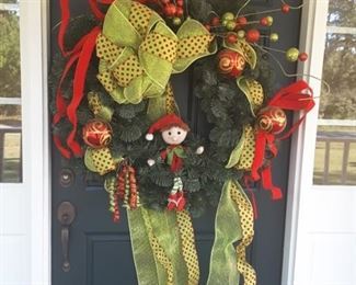 This cheerful Christmas race will greet you at the front door!
