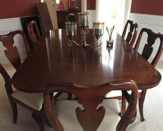 Gorgeous dining room table (with two large leaves) and eight chairs.
