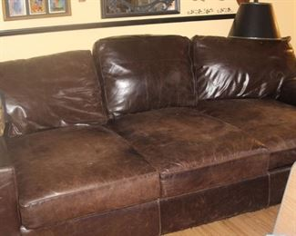 Very deep (front to back) extra long leather couch.
