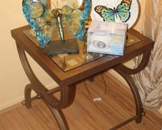 Glass and iron end table with selection of butterfly decor.