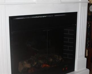 Electric fireplace with working heater.