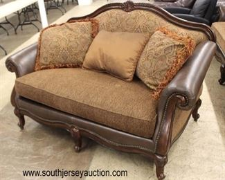 2 Piece Leather and Upholstered Sofa and Loveseat  Auction Estimate $200-$400 – Located Inside