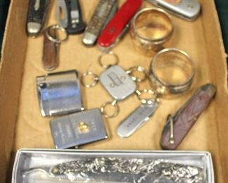 Box Lot of Pen Knives, Lighters, Napkin Rings and more  Auction Estimate $20-$50 – Located Inside